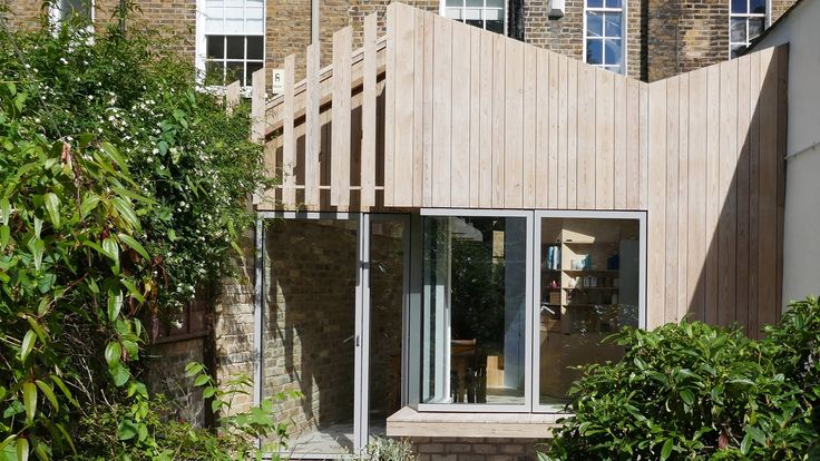 Slats of larch dress this angular addition to a Victorian property in Dalston, which is shortlisted in 2017's Don't Move, Improve! competition.