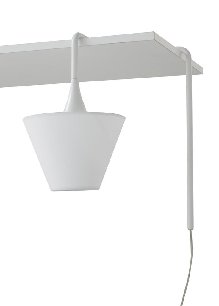"""An OMAGE to Dali's """"persistence of memory"""" . This light by Phillippe Daney drapes over the corner of a shelf or table. Only available in white."""
