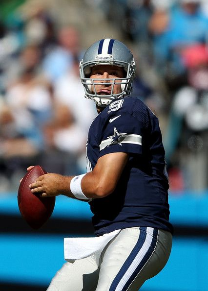 Tony Romo Photos Photos - Tony Romo #9 of the Dallas Cowboys drops back to throw a pass during their game against the Carolina Panthers at Bank of America Stadium on October 21, 2012 in Charlotte, North Carolina. - Dallas Cowboys v Carolina Panthers
