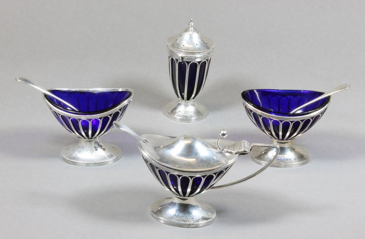 An Adams style silver four piece condiment set with blue glass liners, Birmingham and Chester, est £120-180