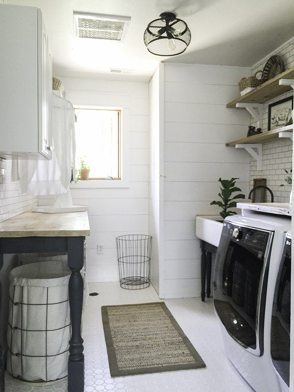LOVE: the hampers, the white subway tile walls, the shelving without having cabinets