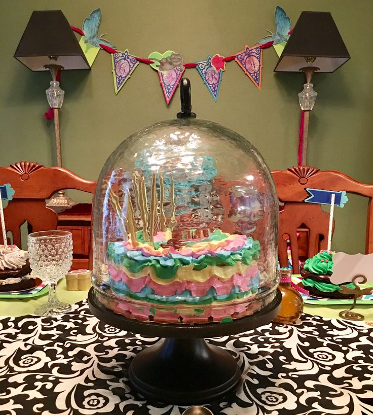 Birthday cake. My new favorite, iron and glass cake stand featured at an Alice in Wonderland Birthday party.