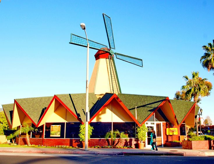 Opened in 1967 as a Van De Camp bakery at the corner of Santa Anita and Huntington Boulevard in Arcadia, this building was designed in late Googie style by Pasadena architects Harold Bissner and Harold Zook to catch the attention of motorists. It later became a Denny's, and the windmill crashed down onto the roof on December 29, 2017. The windmill was the last of its kind in the Southern California area.