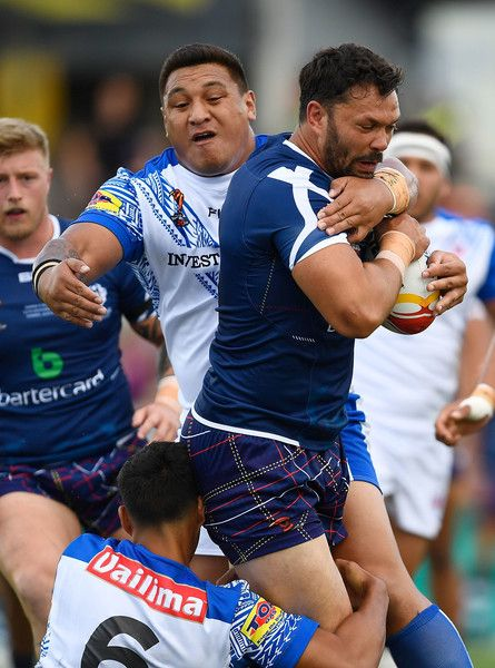 Frankie Mariano of Scotland is tackled by Canberra Raiders Josh Papalii of Samoa during the 2017 Rugby League World Cup match between Samoa and Scotland at Barlow Park on November 11, 2017 in Cairns, Australia.