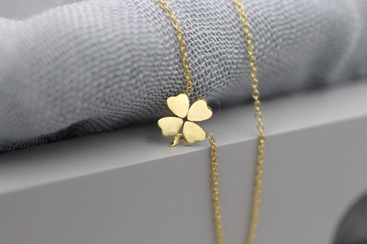 14k solid gold four leaf clover necklace shamrock necklace lucky charm necklace by NOSTALGII on Etsy https://www.etsy.com/listing/219450810/14k-solid-gold-four-leaf-clover-necklace