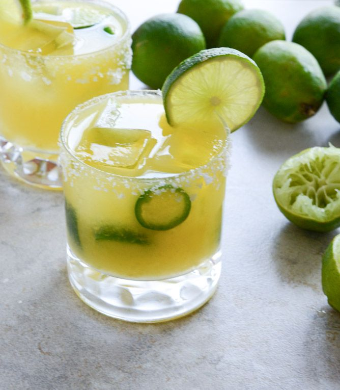 Mango Jalapeño Margaritas-  2 ounces Grand Marnier  1 1/2 ounces jalapeño tequila  2 ounces lime juice  2 1/2 ounces mango simple syrup  1/2 mango, peeled and chopped  2 jalapeño peppers, sliced  salt for the rim  lime wedges