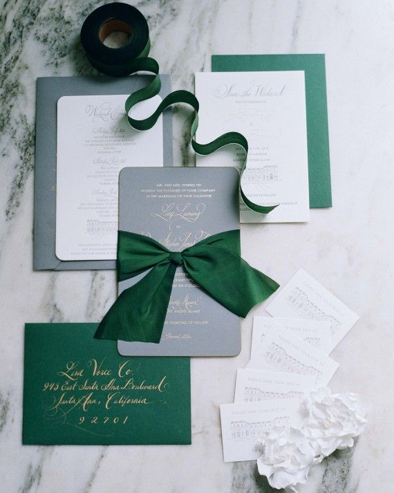 """We wanted something serious but also celebratory for the occasion, so the mix of charcoal gray, dark green, and gold details was perfect,"" Lissy says of the stationery suite, which was designed with help from wedding planner and event designer Lisa Vorce. This classic suite contained a letterpressed save-the date with a sketch of the venue. The pewter gray Papel Paper and Press invitation itself was foil-printed in soft gold on paper with gilded beveled edges. Envelopes were calligraphed…"