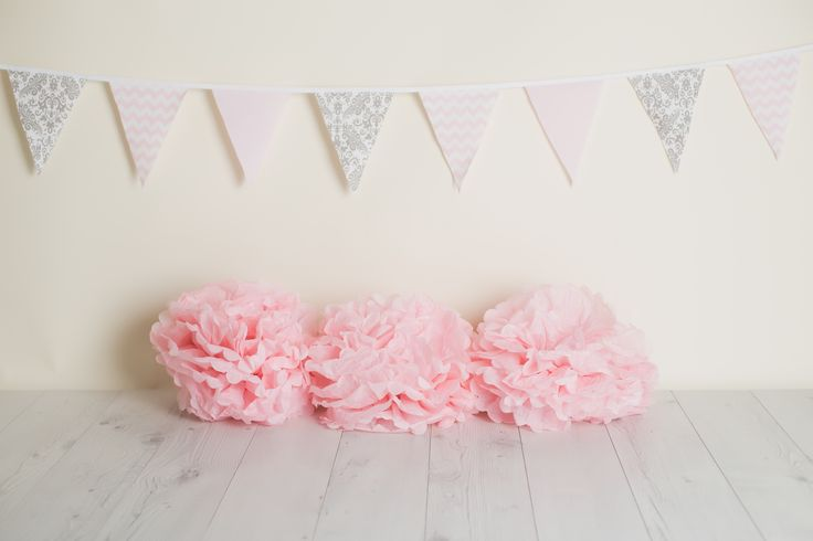 A Cake Smash Photography Shoot for baby's first birthday. Bunting by The Wedding Bunch. Photography by Lullaby Grace Photography.