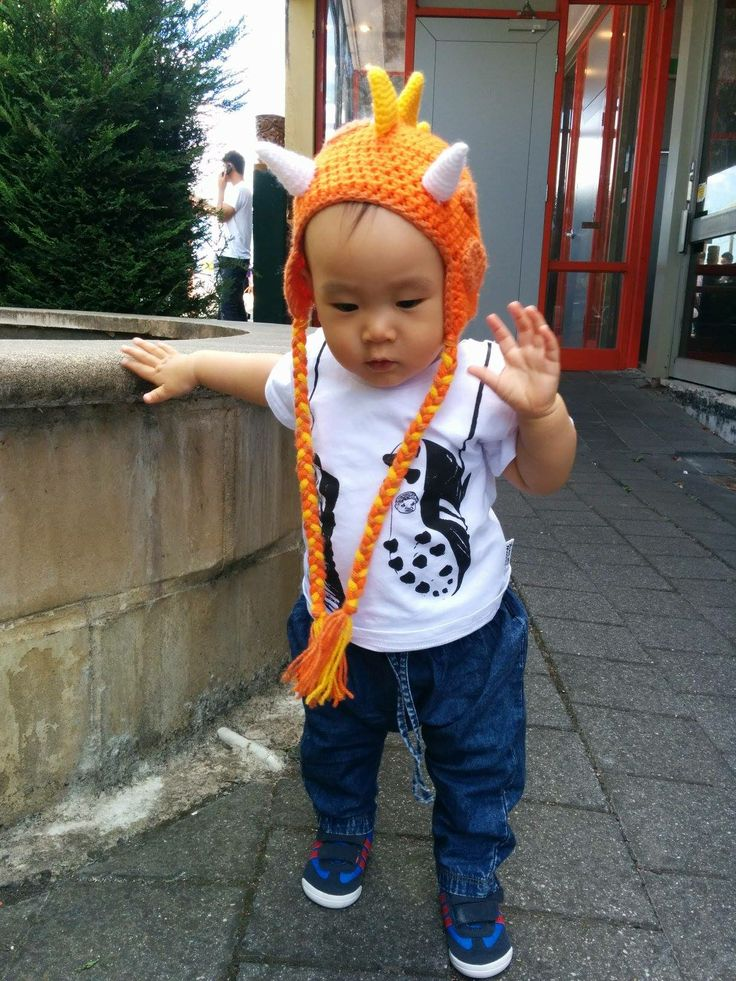 If he was any cuter, I'd have to eat him! The gorgeous Eli wearing his footy boots tee.