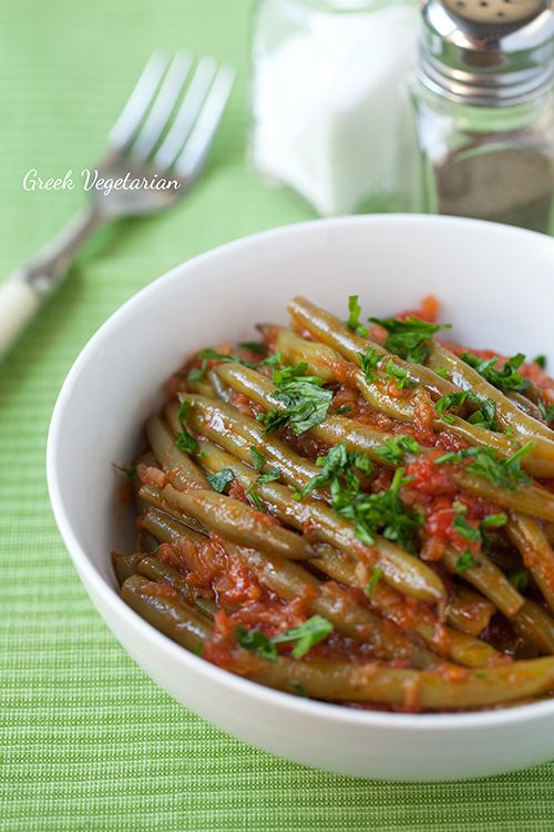 Greek Vegetarian: Fasolakia (Green Bean Stew) 2LBS fresh green beans 100ml good quality olive oil 2 onions, peeled and grated 4 cloves of garlic, minced 8 roma tomatoes, peeled and chopped (or one 400g can of peeled, chopped tomatoes) 100ml water Salt and pepper 2 T parsley