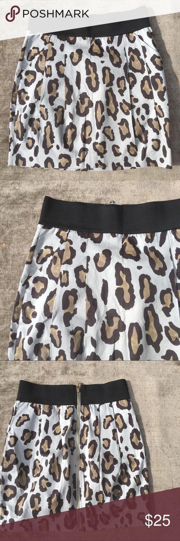 NEW! Armani Exchange pleated animal print skirt 4 Armani exchange animal print (cheetah) cotton skirt. Beautiful pleating in front. Has functioning pockets.  Elastic waistband. New never worn. I have the tags somewhere! Waist 13.5 with a lot of stretch. Hip 18 inches total long 17. Pristine. Size 4 A/X Armani Exchange Skirts Mini