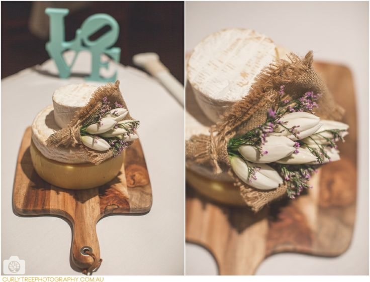 Wedding cake made from Camembert cheese. A cheesy wedding cake with lavendar