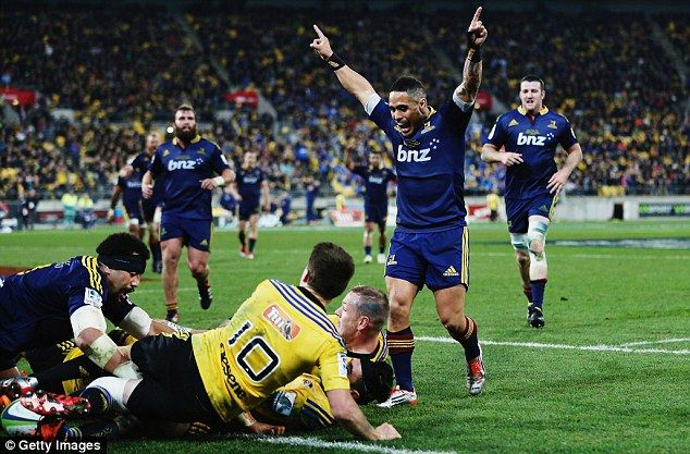 Aaron Smith  celebrates Dixon's try for the Highlanders in their 21-14 win over the Hurricanes in Wellington