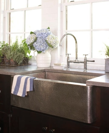 Farmhouse sink. Polished chrome finish faucets and a brushed nickel sink.    Read more: Kitchen Decorating - Ideas for Decorating Your Kitchen - Country Living