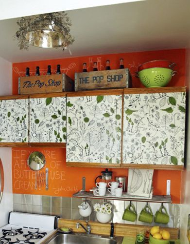 Chalkboard paint backsplash; decorated cupboards; good use of space for small kitchen