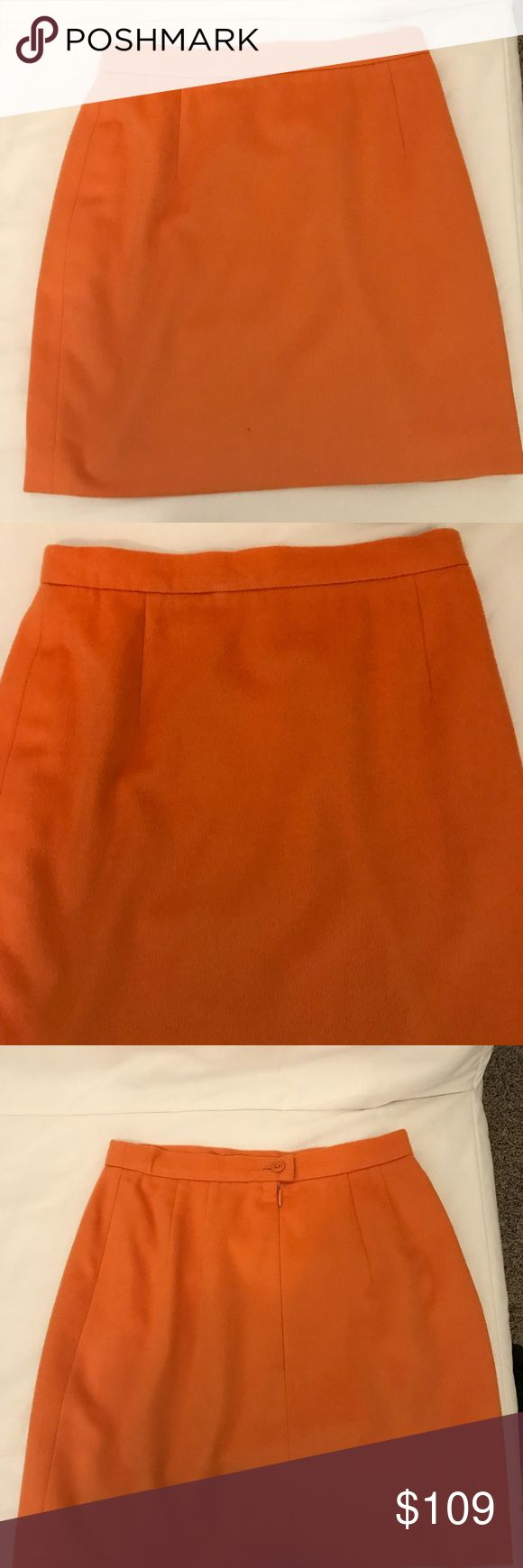 Escada orange pencil skirt This bright sunny skirt is wool/angora with silk lining. There is a small spot on the bottom right and a button (1 of 2) is missing in the back. The price reflects this. Escada Skirts Pencil