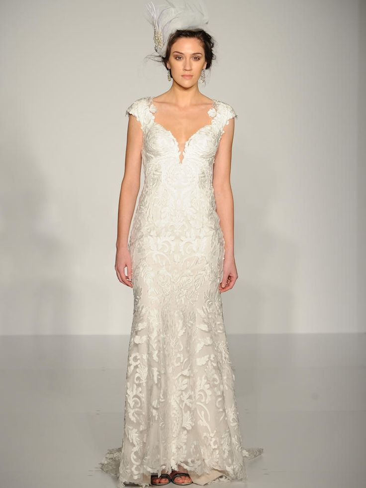 Maggie Sottero lace sheath wedding gown with v neck and cap sleeves: