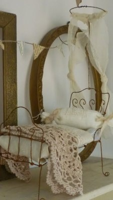 This is adorable, I just hope no one tries to lay on it!  Antique wire bed