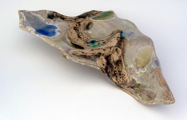 This nightlight holder is inspired by wind blowing across the surface of water and creating little ripples. It is a distinctive unusual piece and is decorated with hand painted oxides, glaze and glass. http://www.marketdirect.ie/large-ripple-nightlight