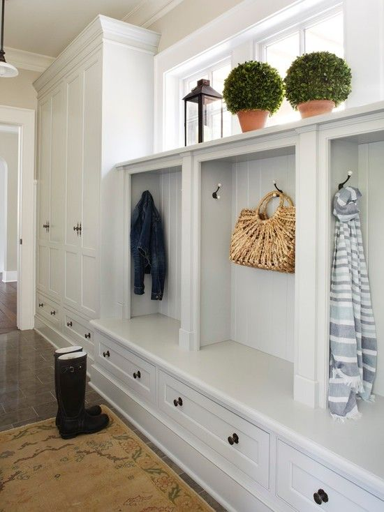 Love this mudroom...built-ins, shelves, high windows for light, white painted woodwork...