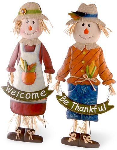 Mrs. & Mr. Autumn Scarecrows - Art Van Furniture - Made of handcrafted and hand painted metal, these 3-dimensional male and female scarecrow characters are a bright and colorful autumn trimming for home or garden. Each piece also features burlap materials, cut straw and knotted twine embellishments for a softened look and added appeal. Hinged rod on backside supports standing position. Display these seasonal decorations indoor or covered outdoor locations.