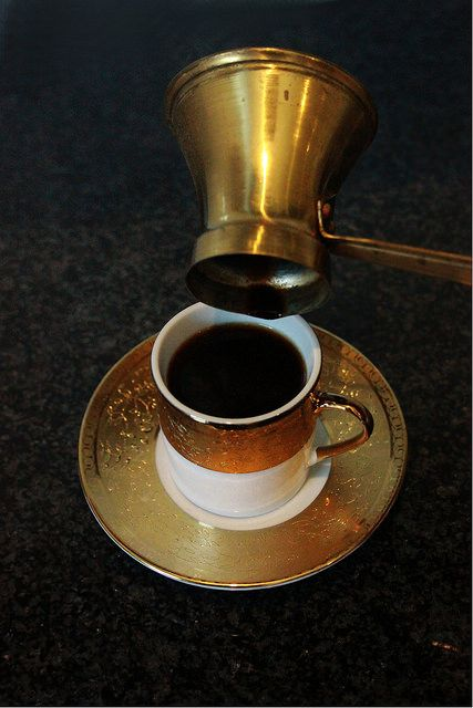 Turkish Coffee-brewed and poured into traditional Fildjan cups using a copper Jezve