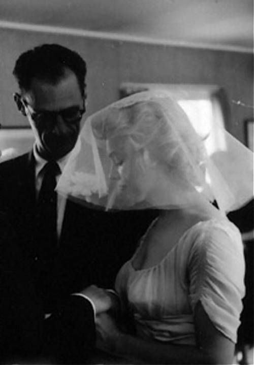 A rare picture of Marilyn and playright Arthur Miller on their wedding day taken by Milton Greene, June 29th 1956.