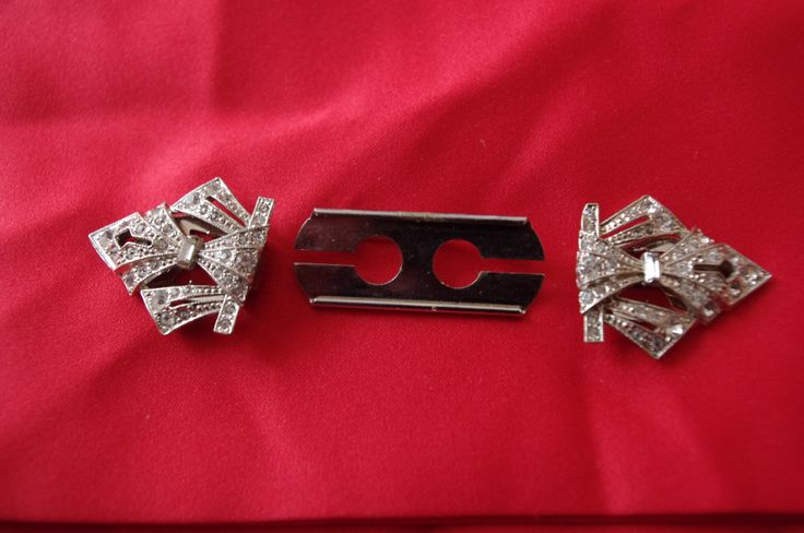 This is a great vintage pin that can be 2 dress clamps or one brooch.  Great example of art nouveau jewellery