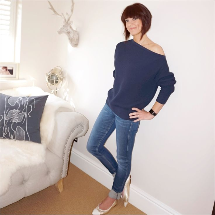 Off the shoulder jumper teamed with straight legged jeans & metallic ballet pumps