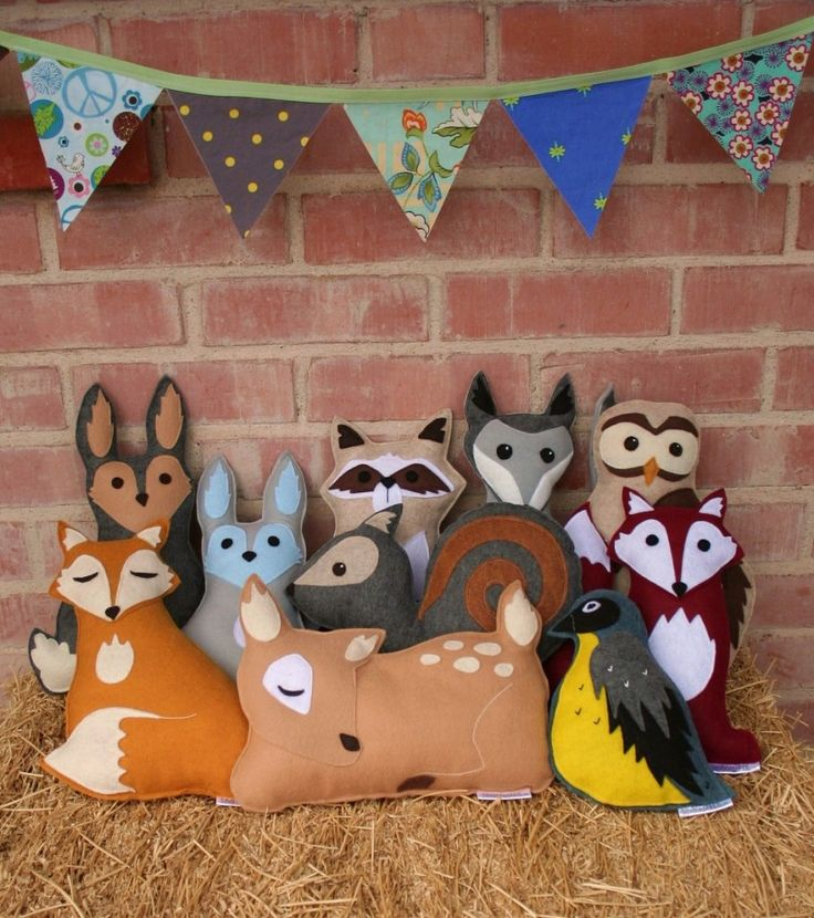 """""""Savage Seeds felt woodland animal toys/cushions -  How about a racoon, squirrel or wolf instead of the ubiquitous owl or fox? The eco-friendly felt is made from 100% recycled post consumer plastic bottles and bamboo fibre forms the stuffing, so no nasties. Each toy/cushion costs about 23 Pounds, plus a further 5 Pounds postage to the UK, but that includes a cute free gift of seed-infused plantable heart and personalisation, should you want it."""""""