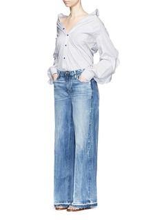 TORTOISEFrayed cuff wide leg jeans
