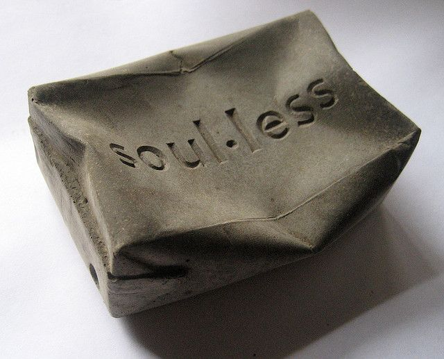 'soul.less' concrete squashed drink carton
