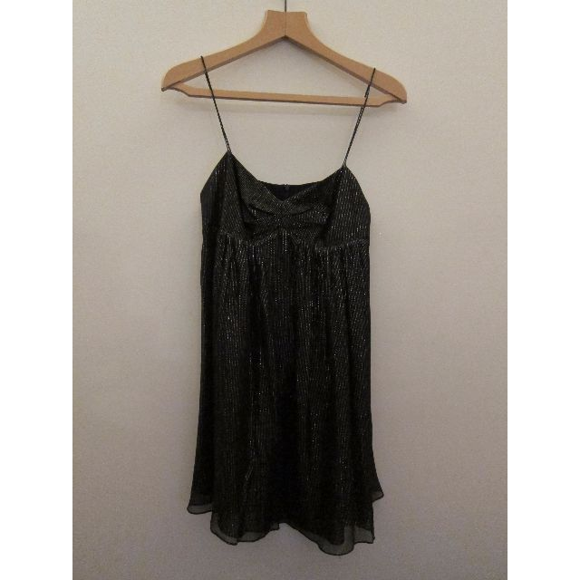 Used but rarely worn and in Excellent Condition.Metallic Flecks in Black Outer Fabric.Zip detail on back.Flowing Skirt with black lining.