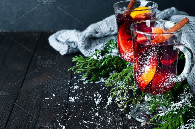 Christmas mulled wine with spices in glass, by Yuliia Mazurkevych photo on @creativemarket