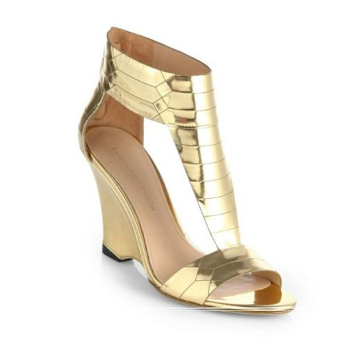 """Sigerson Morrison Ruby Gold Metallic Wedge Sandal Size 8.5 Retail $395.00 Sale $275.00. Elaborate geometric etchings  lend contemporary style to this elegant t-strap silhouette in polished gold metallic leather.  A self covered 4"""" wedge heel with back pull zip closure, providing stylish flare, as well as easy off and on access. A gorgeous ankle cuff elongates the leg, open side panels and dainty toe add a chic look to these feminine sandals. Another fantastic shoe by SM."""