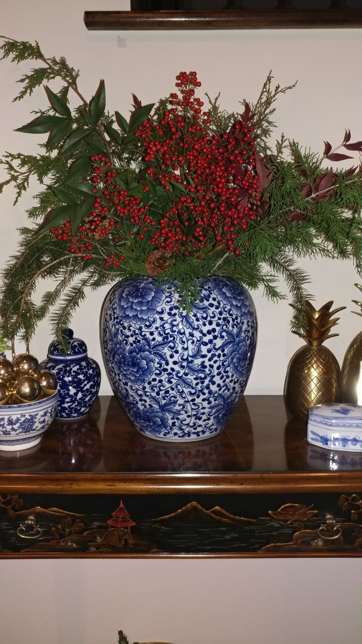 Holiday arrangement in Williams Sonoma ginger jar. Maitland Smith table.