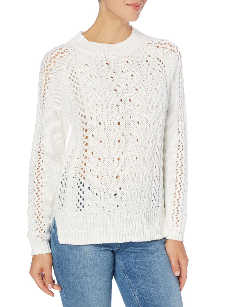 A must-have for your seasonal collection, this classic cream jumper features a…