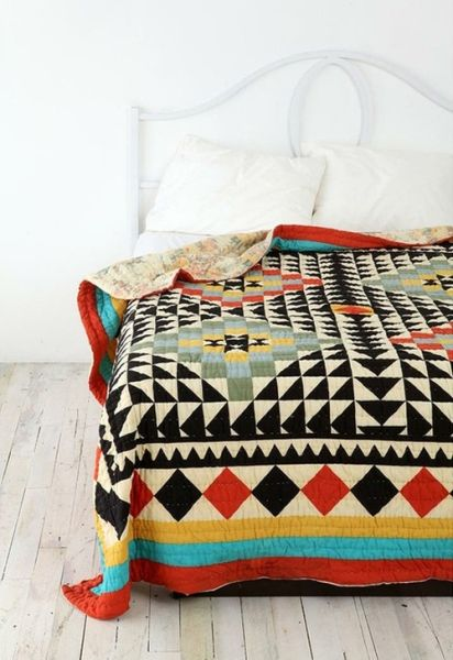 patterned quilt + white bedroom