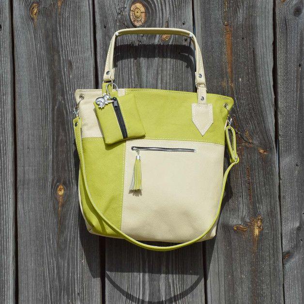 Seria kwadraty, Model: Limonka Praktyczna torebka wykonana z wysokiej jakości naturalnej skóry bydlęcej w kolorze kremowym i jasnym zielonym.  Zamykana na zamek. Z przodu kieszeń 13,5x15cm z...