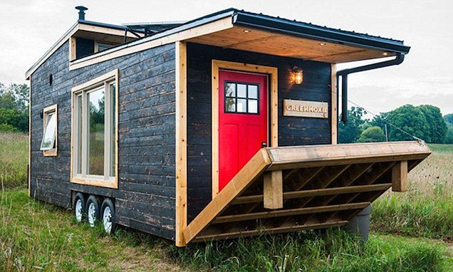 Tiny mobile home with solar panels, bedroom and  drawbridge for $65K