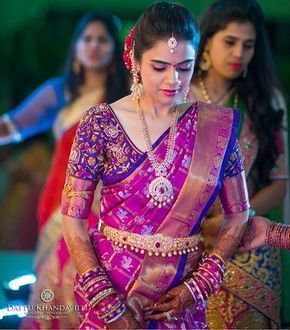 South Indian bride. Diamond Indian bridal jewelry.Temple jewelry. Jhumkis.Pink and purple silk kanchipuram sari.Braid with fresh jasmine flowers. Tamil bride. Telugu bride. Kannada bride. Hindu bride. Malayalee bride.Kerala bride.South Indian wedding.