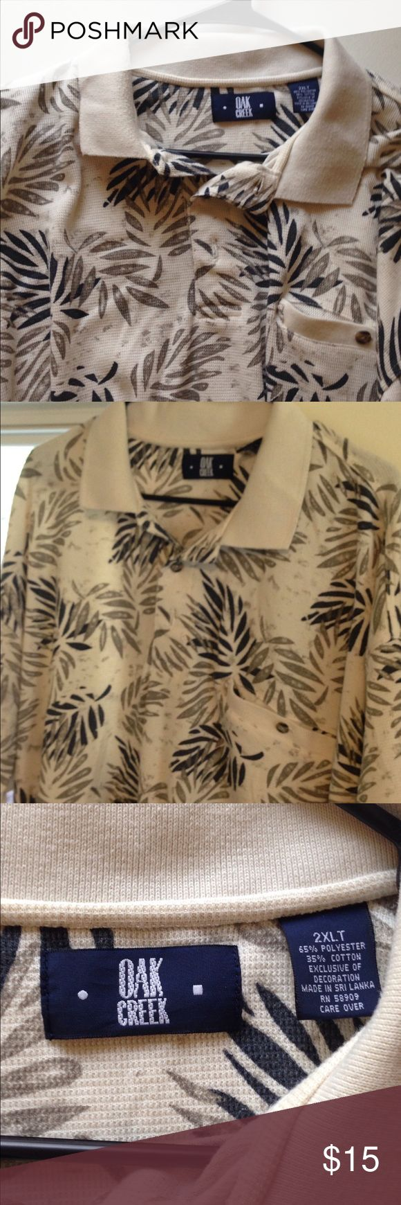 2XL Leaf Print Oak Creek Men's Polo Shirt This Oak Creek polo shirt is in great used condition! It features a printed design and is a size 2XL Oak Creek Shirts Polos