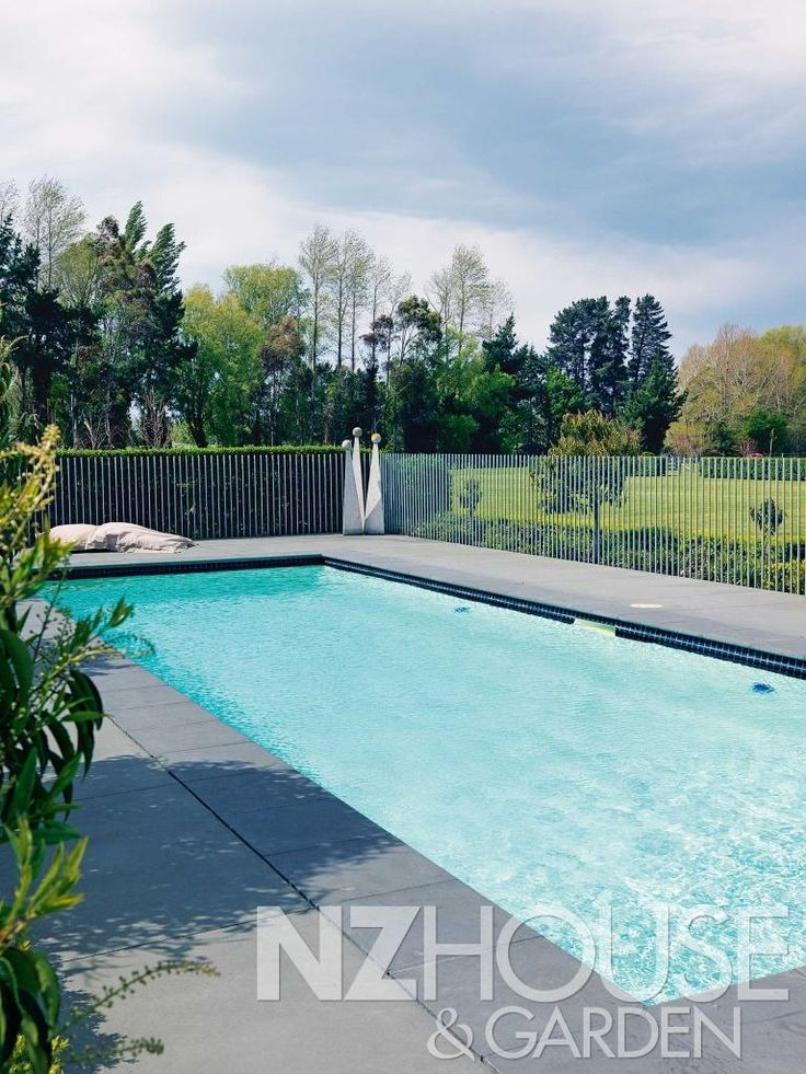 The pool fence, minus any capping, adds to the industrial, architectural feel of the house.