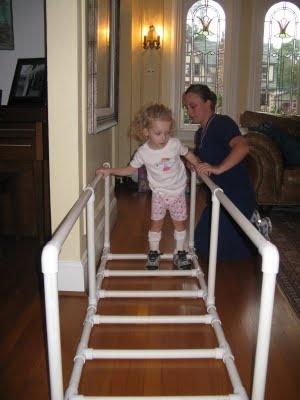 Grace in her homemade PVC walking frame