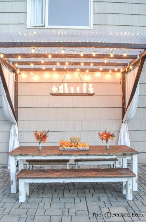 This Restoration Hardware inspired outdoor chandelier is the perfect complement to any dining area (indoors or out) and it looks stunning with a pergola! Get the tutorial from The Created Home on Remodelaholic.com