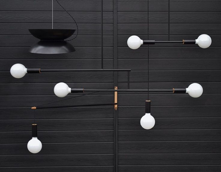 This dramatic accent piece, perfect for any living or bedroom, is actually quite versatile. The lamp can pivot 180-degrees, and can be lowered to any height by feeding the cable through the pivoting rod. The light is made of black or white powder-coated steel with oak accents, and is available in 2-6 ft. arm lengths. Lightbulb not included, but a G40 Globe Light is recomm