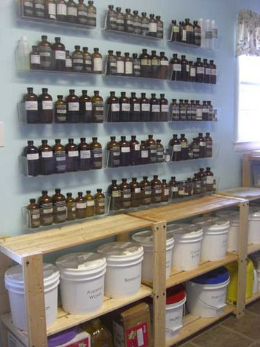 Great storage for essential oils - dream space - shelving for my buckets of ingredients too