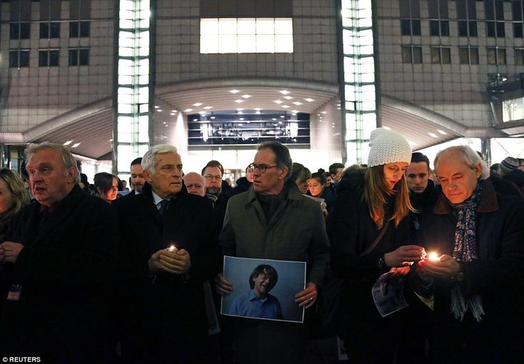 Members of the European Parliament, above, were among those who took to the streets of Brussels to pay tribute of today's attack