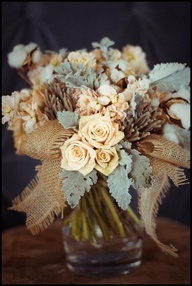 Raw cotton, burlap, roses, and dusty miller bouquet. I like the burlap and cotton need brighter colors