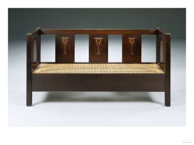 Gustav Stickley (1858-1942) & Harvey Ellis (1852-1904) (Designer) - Settle. Oak with Pewter, Brass, Copper and Fruitwood Inlays and a Cane Seat. Circa 1903.